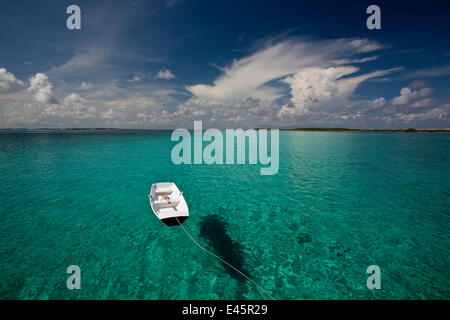 Tethered tender floating on clear waters in the Exumas, Bahamas, Caribbean. June 2009. - Stock Photo