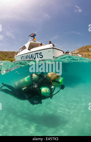 Split level view of scuba diver with PR Aquanauts boat in Grenada, Caribbean. May 2009. Model released, property - Stock Photo