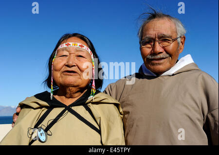 Portrait of elderly Inuit couple, Pond Inlet village, Baffin Island, Nunavut, Canada, August 2010 - Stock Photo