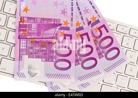 € 500 banknotes on a pile.On a computer keyboard - Stock Photo