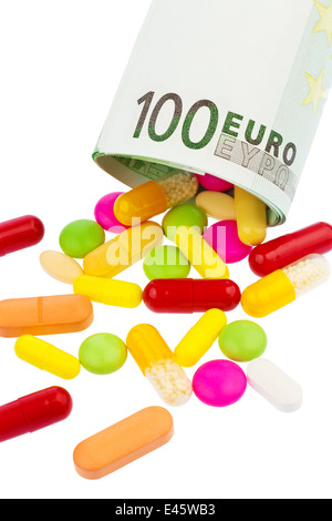 100 € note and tablets on white background. - Stock Photo