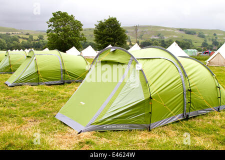 ... Pre-pitched tents in a field accommodation in Kilnsey Yorkshire Dales UK & tents erected in field at camping exhibition in Derbyshire England ...