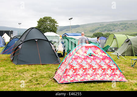 Pre-pitched tents in a field accommodation in Kilnsey Yorkshire Dales UK & A tent pitched up in a field near Clifton Hampden bridge on the ...