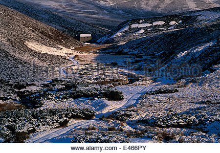Disused manganese mine in snowy valley. The Lecht, Tomintoul, Moray, Scotland. - Stock Photo