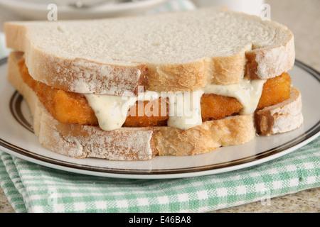 Fish Finger Sandwich with tartare sauce a popular British comfort food - Stock Photo