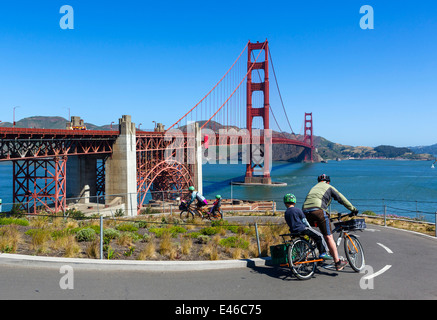 Cyclists on cycle path in front of the Golden Gate Bridge looking towards Sausalito, San Francisco, California, - Stock Photo