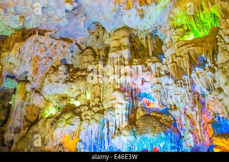 Famous cave in Halong bay illuminated by colorful lights, Vietnam, Southeast Asia - Stock Photo