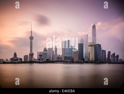 Shanghai, China cityscape viewed across the Huanpu River at dawn. - Stock Photo