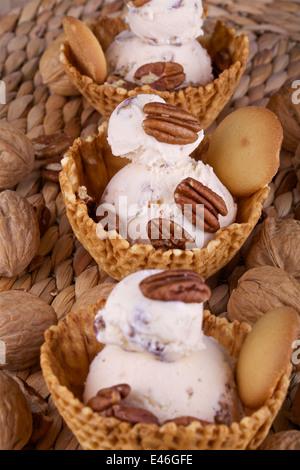 Three peanut Ice cream in waffle bowls - Stock Photo