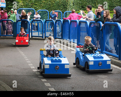 children driving the L-Drivers cars at Legoland Windsor - Stock Photo