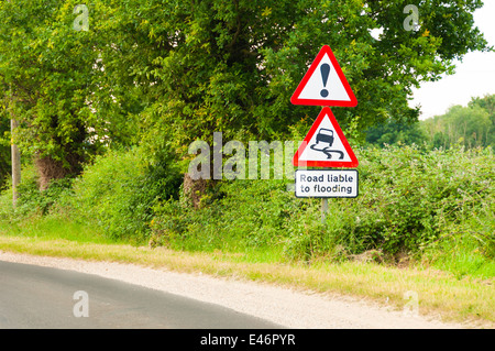 Road liable to flooding warning sign on countryside road - Stock Photo