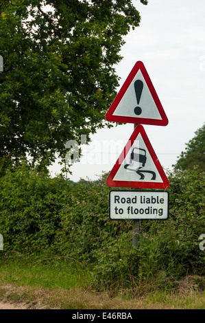 Road warning sign liable to flooding - Stock Photo