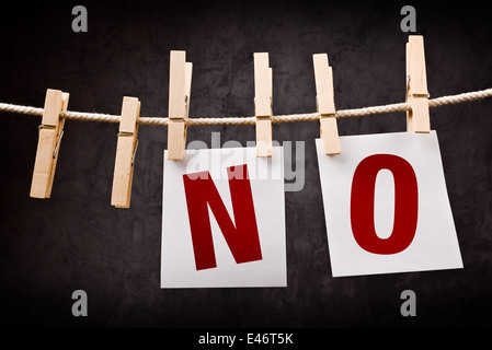 No. Deny and disapprove concept. Word printed on note paper hanging on rope. - Stock Photo