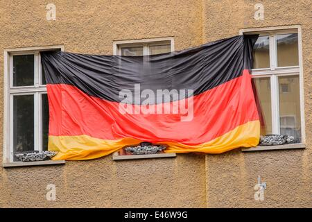 Berlin, Germany. 2nd July, 2014. A Germany-flag hangs on a facade of a building, on July 2, 2014 in Berlin, Germany. - Stock Photo