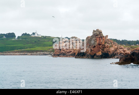 coastal scenery including a rock formation at the Pink Granite coast in Brittany, France - Stock Photo