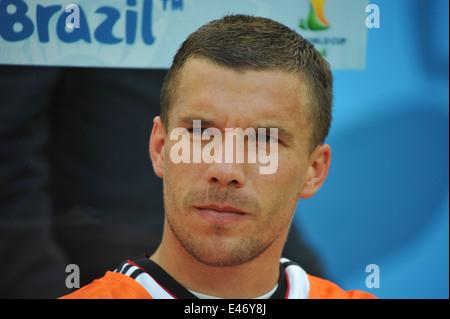 WM 2014, Salvador da Bahia, Lukas Podolski auf der Bank, Deutschland vs. Portugal. Editorial use only. - Stock Photo