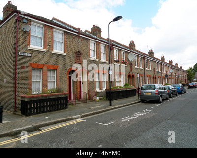 Row of terraced houses on April Street with disabled parking space marked Dalston Hackney East London E8 England - Stock Photo