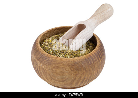 Portion of dried Winter Savory spice in wooden bowl isolated on white background with clipping path - Stock Photo