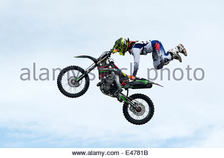 Image of an Motor-Cross rider preforming mid air stunts with his bike at the Extreme Torque show in Sunderland U.K. - Stock Photo