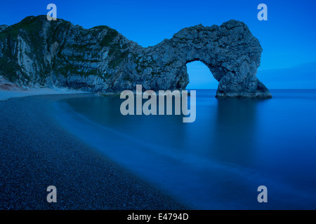 Night over Durdle Door along the Jurassic Coast, Dorset, England - Stock Photo