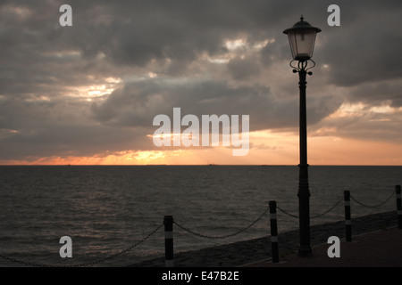 Sunset in the Netherlands seen from boulevard of Urk - Stock Photo