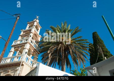 Griechenland, Rhodos, Lardos, Palme mit Kirchturm - Stock Photo