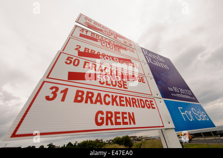 For sale signs with most displaying 'SOLD' - Stock Photo