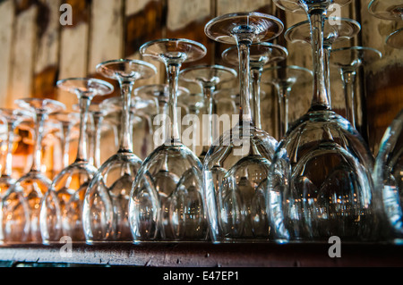 Wine glasses on a shelf in a bar. - Stock Photo