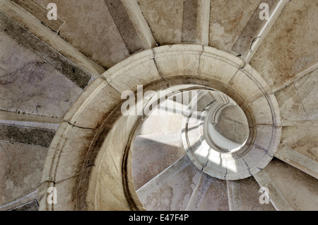 spiral stone stairway inside an old palace - Stock Photo