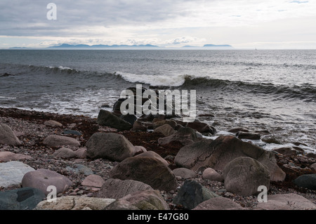 Looking at the Isle of Skye from Melvaig shore on a cloudy day across The Minch, Scotland - Stock Photo
