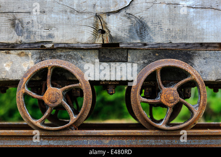 Two rusting wheels on an old and disused mining carriage, Auchinleck, Ayrshire,Scotland, UK - Stock Photo