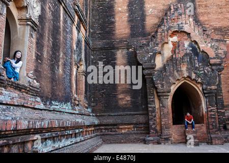 Tourists inside Dhammayangyi temple (Dahmmayan Gyi Phaya ) in Bagan, Myanmar (Burma) - Stock Photo