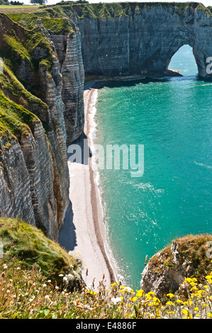 Beach and cliffs at Étretat Seine Maritime, Normandy, France - Stock Photo