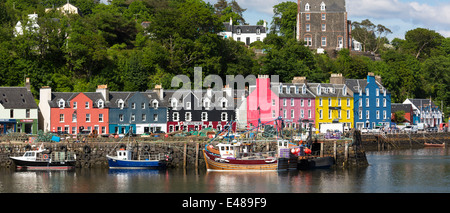 Multi-coloured buildings on the waterfront at Tobermory the capital city of the Isle of Mull in the Inner Hebrides - Stock Photo