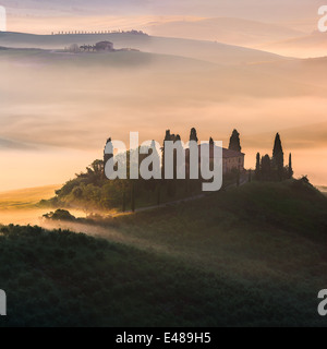 Famous Podere Belvedere in morning light, in the heart of the Tuscany, near San Quirico in de Val d'Orcia valley - Stock Photo
