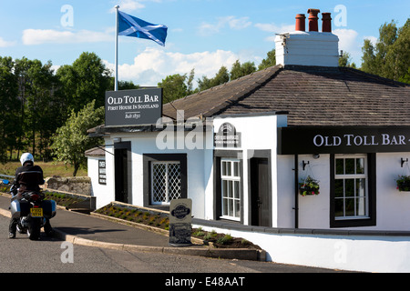 Scottish flag, the Saltire, on the First House in Scotland on the Scottish/English border at Gretna - Stock Photo