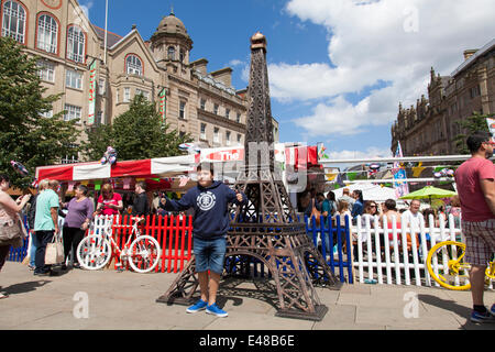 Fargate, Sheffield, U.K. 5th July, 2014.  A boy poses for photographs next to a model of the Eiffel Tower on Fargate - Stock Photo