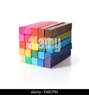 The cube from multicolored artist's pastels isolated on white background - Stock Photo
