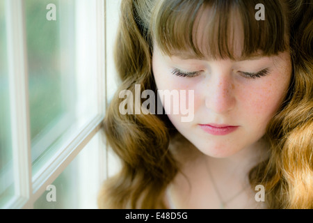 Portrait of girl (13-15) with eyes closed