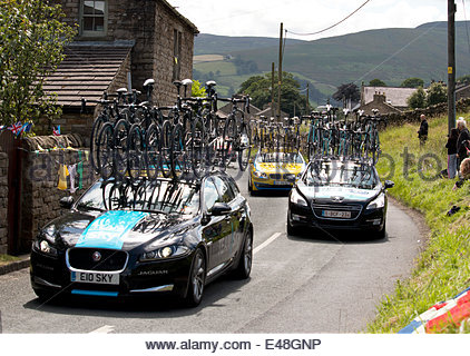 Low Row, Swaledale in North Yorkshire UK 5th July 2014  Day one of the Grand Depart, Tour de France 2014 Cars carrying - Stock Photo