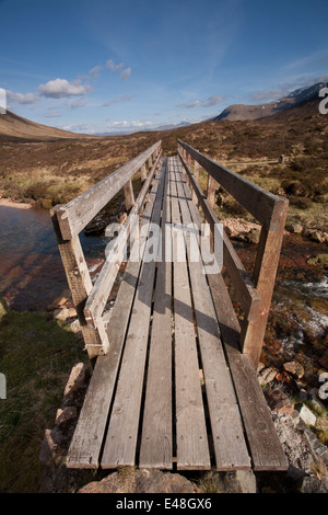 Footbridge over the River Coupall, Glen Coe. - Stock Photo