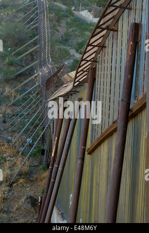 Detail of US border fence in Nogales Arizona USA, looking southeast toward Sonora Mexico - Stock Photo