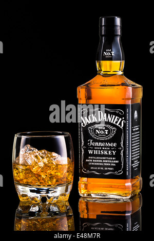 Jack Daniel's whiskey bottle and glass. Jack Daniel's is a brand of sour mash Tennessee whiskey and the highest - Stock Photo