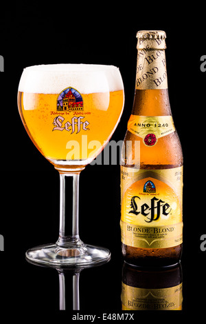 Leffe beer bottle and glass. Leffe is a beer brand owned by InBev Belgium marketed as Abbey beer. - Stock Photo