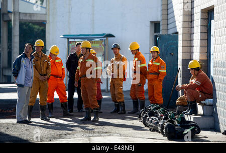 Fukang, China, 6th July, 2014.  Rescuers wait to enter the pit where a gas blast traps 17 miners at the No. 1 coal - Stock Photo