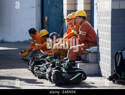 Fukang, China, 6th July, 2014.  Rescuers wait for work outside an entrance of the pit where a gas blast traps 17 - Stock Photo