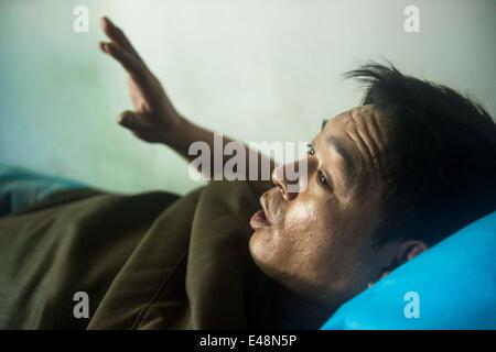 Fukang, China, 6th July, 2014.  Rescued miner Duan Xukang tells about his escape experience during a coal mine gas - Stock Photo