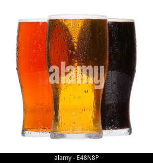 Different chilled refreshing pints of Beer, lager and stout served by the Alcoholic drinks industry - Stock Photo