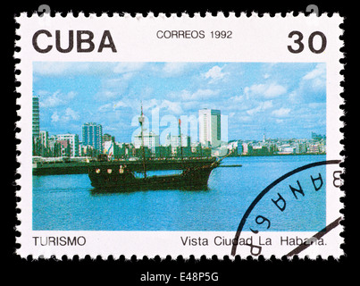 Postage stamp from Cuba depicting a sailing boat in Havana - Stock Photo