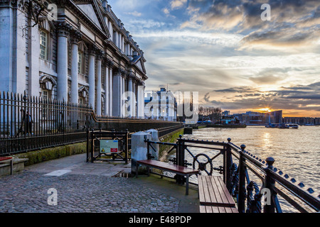 Sunset view of the Old Royal Naval College and river Thames from the Thames path in Greenwich, London, UK - Stock Photo
